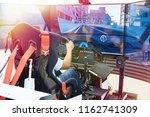 man plays on a computer racing...   Shutterstock . vector #1162741309