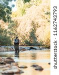 fly fisherman using flyfishing... | Shutterstock . vector #1162743793