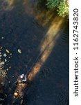 fly fisherman using flyfishing... | Shutterstock . vector #1162743820