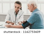young female doctor examining... | Shutterstock . vector #1162753609