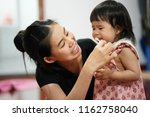 mother is teaching her kid to... | Shutterstock . vector #1162758040
