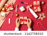 female hands wrapping a... | Shutterstock . vector #1162758310