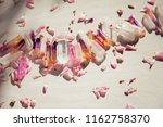 Stock photo colorful quartz crystals with pink rose leaves on wooden structure flat lay background 1162758370
