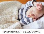 adorable baby girl sleeping in... | Shutterstock . vector #1162779943