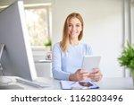 portrait of happy young...   Shutterstock . vector #1162803496