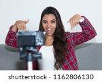posing latin american... | Shutterstock . vector #1162806130