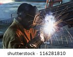 Welder Worker Welding Metal By...