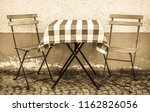 table and chair at a sidewalk...   Shutterstock . vector #1162826056