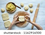 cooking cake with potatoes.... | Shutterstock . vector #1162916500