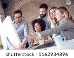 young coworkers are sitting... | Shutterstock . vector #1162934896