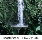 a fresh wild white waterfall... | Shutterstock . vector #1162944283