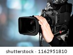 cameraman with his camera on... | Shutterstock . vector #1162951810