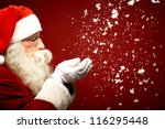 photo of santa claus blowing... | Shutterstock . vector #116295448