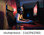 a cute female gamer girl sits... | Shutterstock . vector #1162962583