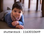 cute baby boy under the table... | Shutterstock . vector #1163010649