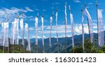 buddhist prayer flags in the... | Shutterstock . vector #1163011423