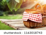 picnic basket with napkin on... | Shutterstock . vector #1163018743