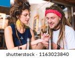 red headband. hippie man... | Shutterstock . vector #1163023840
