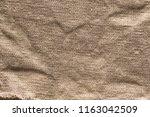 sackcloth background wrinkled...   Shutterstock . vector #1163042509
