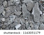 grey crushed stones in close up ... | Shutterstock . vector #1163051179