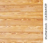 yellow wood wall background | Shutterstock . vector #1163064439