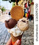a female hand holding ice cream ... | Shutterstock . vector #1163091700