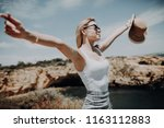 young woman is standing on a... | Shutterstock . vector #1163112883