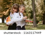schoolgirls do homework in... | Shutterstock . vector #1163117449