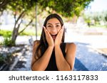 young beautiful woman surprised ... | Shutterstock . vector #1163117833