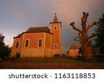 last vague sunlight on the... | Shutterstock . vector #1163118853