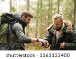 man with a backpack and beard... | Shutterstock . vector #1163133400