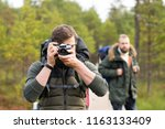 man with a backpack and beard... | Shutterstock . vector #1163133409