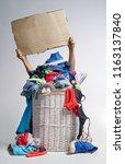 full laundry white wicker...   Shutterstock . vector #1163137840
