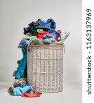 full laundry white wicker...   Shutterstock . vector #1163137969
