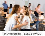 two girls friendly greeting... | Shutterstock . vector #1163149420