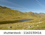 red tarn beneath crinkle crags  ... | Shutterstock . vector #1163150416