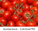 red tomatoes on vegetable market | Shutterstock . vector #1163166790