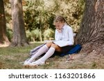 a schoolgirl does lessons in a... | Shutterstock . vector #1163201866