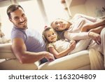we're happier together. family... | Shutterstock . vector #1163204809