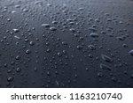 water drops on a waterproof...   Shutterstock . vector #1163210740