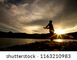man fishing at sunset | Shutterstock . vector #1163210983