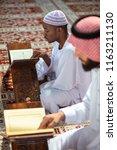 two religious muslim man...   Shutterstock . vector #1163211130