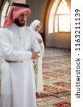 muslim man and woman praying in ...   Shutterstock . vector #1163211139