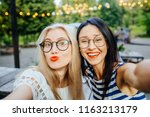 party  hangout for two young... | Shutterstock . vector #1163213179