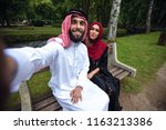 young beautiful arabian couple...   Shutterstock . vector #1163213386