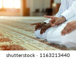 two religious muslim man... | Shutterstock . vector #1163213440