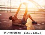 fitness training outdoors.... | Shutterstock . vector #1163213626