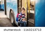 cute small boy is entering a... | Shutterstock . vector #1163213713