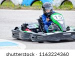 karting   driver in helmet on... | Shutterstock . vector #1163224360