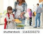 little girl choosing school... | Shutterstock . vector #1163233273